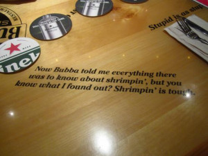 Bubba Gump Shrimp Company: Tables are covered in movie quotes.