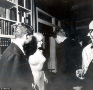 ... John F Kennedy and his brother Bobby (left) with Marilyn Monroe