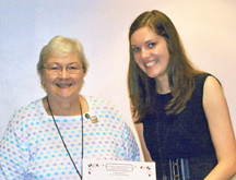 leah nightingdale right is shown receiving a scholarship from rose ...