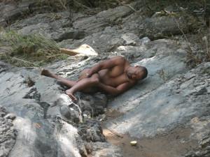 Danilo asleep on a river outing