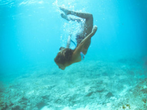 She would be half a planet away, floating in a turquoise sea, dancing ...