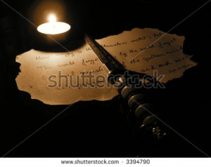 stock-photo-poem-on-burnt-paper-and-paper-cutter-3394790.jpg