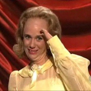 Kristin Wiig sporting big forehead, little hands in a Lennon Sisters ...