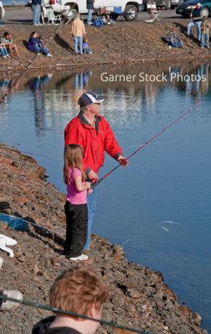 grandpa helps granddaughter fish this caucasian grandfather is helping ...