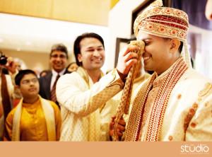 Indian wedding groom getting ready