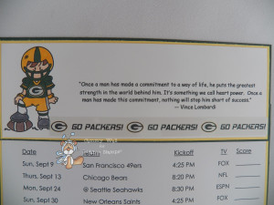 The football player has a Packers G from the sticker sheet on his ...