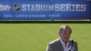 NHL Commissioner Gary Bettman speaks at a news conference on the field ...