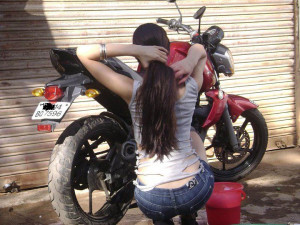 girl cleaning her bike now these days girls not knows riding but ...