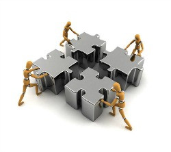 putting together a jigsaw, representing team work. Team development ...