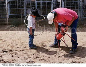 Father Teaching Son How to Lasso
