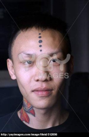 Young asian man tattoo with neck and forehead portrait