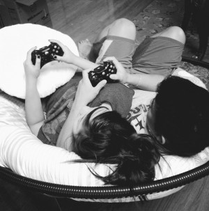 ... how cute they are. [H/T/N] [Y/T/N] relaxing playing video games