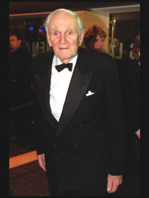 Desmond Llewelyn arrives at the European Premiere of the latest James ...