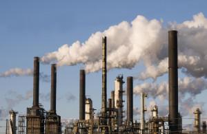 Oil refinery with smoke stacks against a blue sky ©iStockphoto.com ...