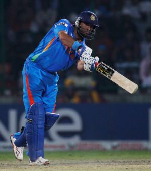 Yuvraj Singh comes down the wicket