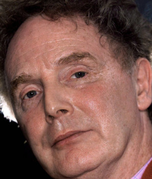 Malcolm McLaren exhales smoke as he sits in his north London studio in ...