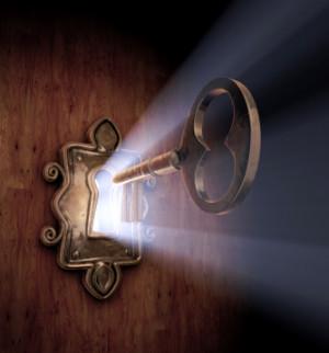 close-up of a key moving towards the key hole.