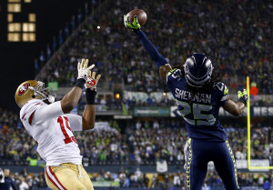 Seahawks cornerback Richard Sherman tips a pass in the end zone ...