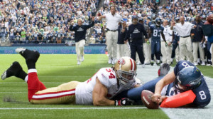 ... Seahawks' first touchdown on a 1-yard run as 49ers linebacker Travis