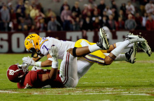 of the LSU Tigers tackles Michael Williams #89 of the Alabama ...