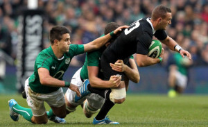 New Zealand's out-half Aaron Cruden (R) is tackled by Ireland's scrum ...