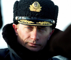 Wearing a Navy cap and a greatcoat, President Vladimir Putin observes ...