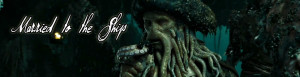 Davy Jones steps down the stairs eyeing Will and the crew