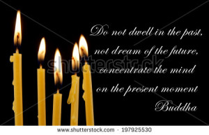 Buddha quote on black background with candles - stock photo