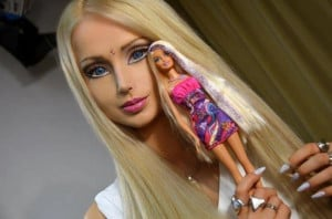 The Ukrainian model holds up a Barbie doll, the inspiration for her ...
