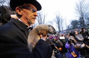 file photo, Groundhog Club handler Ron Ploucha holds Punxsutawney Phil ...