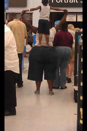Kid_standing_on_fat_ass.jpeg