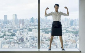Business woman flexing muscles with city view. - Petri Artturi ...