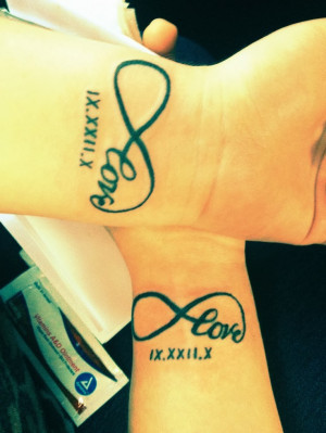 Couple tattoo, love infinity with the date in Roman numberals on wrist