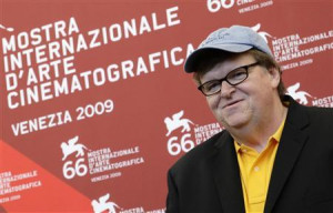 director Michael Moore poses during a photocall at the 66th ...