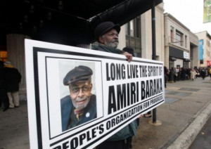 Nello Ramsey of East Orange, N.J., holds a sign outside the funeral ...