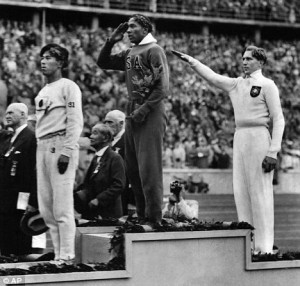 Snubbed: American sporting hero Jesse Owens taking gold at the Berlin ...