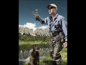 Man fly fishing with dog