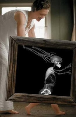 ... picture of a mother playing with her child, with a creepy x-ray frame