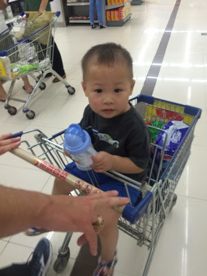 Our next stop was the supermarket to get this guy a different sippy ...
