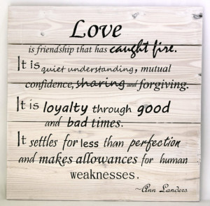 Ann Landers quote on love. White wash stain with flat black font on a ...