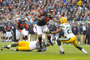 Brandon Marshallbreaks a tackle by Green Bay Packers cornerback Casey ...