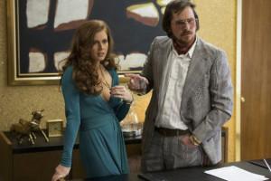 Amy Adams, Christian Bale in American Hustle