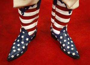 sports American flag-inspired cowboy boots. (AP Photo/Jae C. Hong