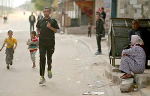 Palestinian Olympic runner Nader Al Masri runs near his house in Beit