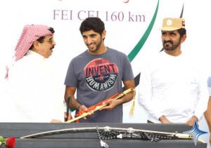 Mohammed and Hamad bin Isa awarding the prize to Sheikh Hamdan