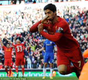 Suarez kisses his wedding ring and his right wrist, where he has his ...