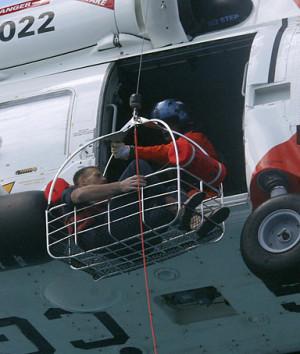 Coast Guard crewmembers rescue Nick Schuyler.
