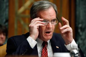 Senate Budget Committee ranking member Sen Judd Gregg R HN raises
