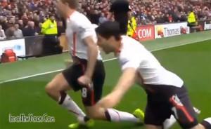 Watch Luis Suarez Trying to Bite Steven Gerrard -GIF-