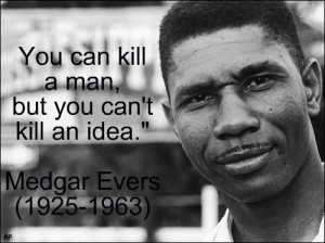 Medgar Evers stands near a sign of the state of Mississippi in 1958 ...